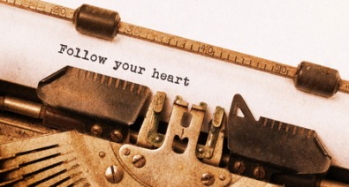 55506112 - vintage typewriter close-up - follow your heart message