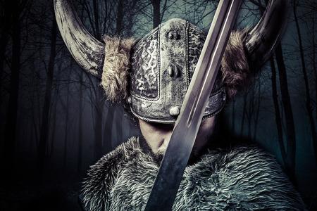 33603618 - sword, viking warrior with helmet over vintage textured background