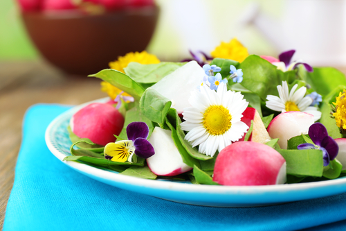 Light organic salad with flowers, close up